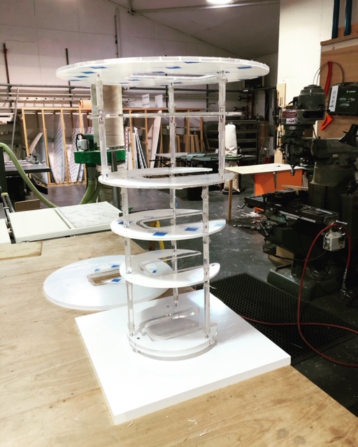looks like a spaceship meets cake stand, but this well engineered acrylic fabrication represents parts of a scientific instrument used to rapidly cool items inside a laboratory. The centre of the Perspex discs have been machined out to take the original part